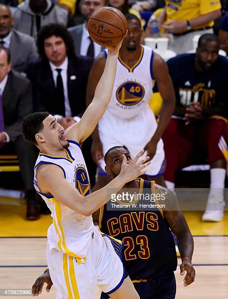 Klay Thompson of the Golden State Warriors goes up against LeBron James of the Cleveland Cavaliers in the second half during Game One of the 2015 NBA...