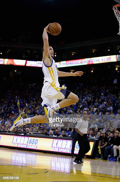 Klay Thompson of the Golden State Warriors goes up for a dunk against the Los Angeles Lakers at ORACLE Arena on November 1 2014 in Oakland California...