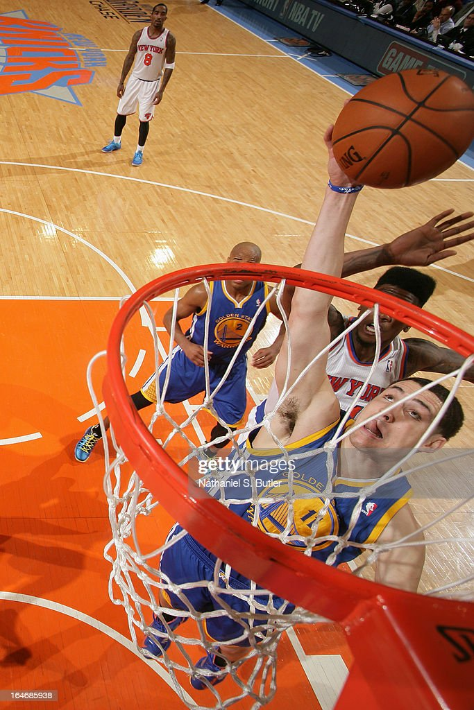 Klay Thompson #11 of the Golden State Warriors goes up for a rebound against the New York Knicks on February 27, 2013 at Madison Square Garden in New York City.