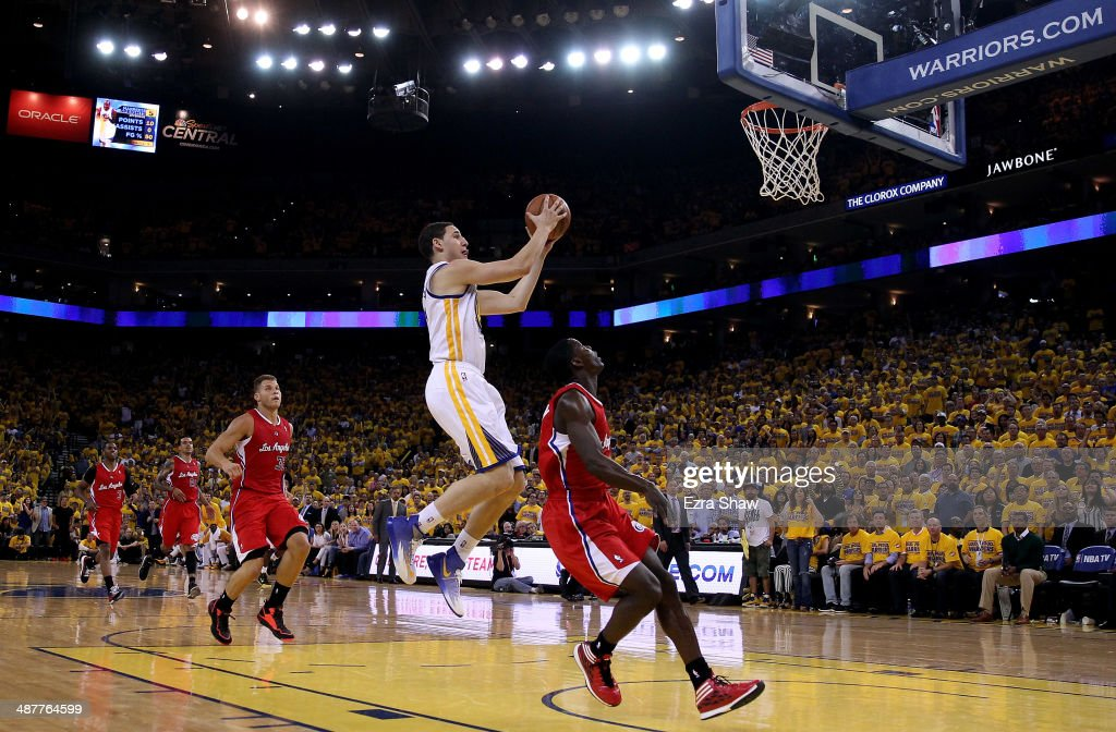 Klay Thompson #11 of the Golden State Warriors goes up for a shot against the Los Angeles Clippers in Game Six of the Western Conference Quarterfinals during the 2014 NBA Playoffs at ORACLE Arena on May 1, 2014 in Oakland, California.