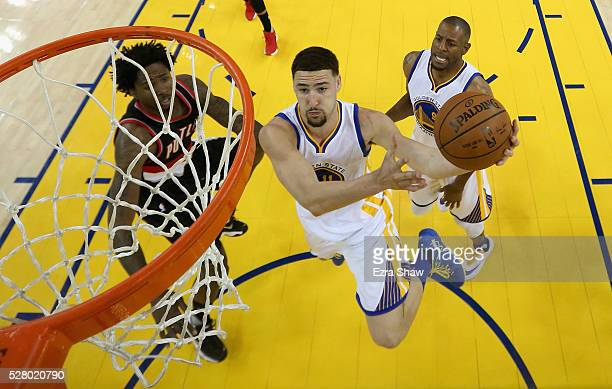 Klay Thompson of the Golden State Warriors goes up for a shot against Ed Davis of the Portland Trail Blazers during Game Two of the Western...
