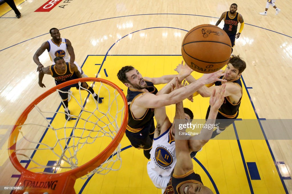 Klay Thompson #11 of the Golden State Warriors goes up for a shot against Kevin Love #0, Kyle Korver #26, and Richard Jefferson #24 of the Cleveland Cavaliers in Game 1 of the 2017 NBA Finals at ORACLE Arena on June 1, 2017 in Oakland, California.