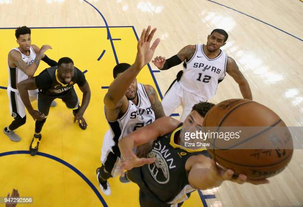 Klay Thompson of the Golden State Warriors goes up for a shot against Rudy Gay of the San Antonio Spurs during Game 2 of Round 1 of the 2018 NBA...