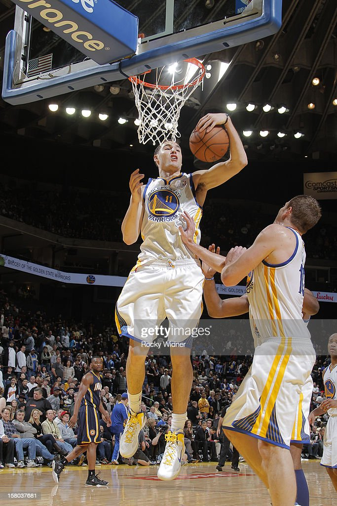 Klay Thompson #11 of the Golden State Warriors grabs the rebound against the Indiana Pacers on December 1, 2012 at Oracle Arena in Oakland, California.