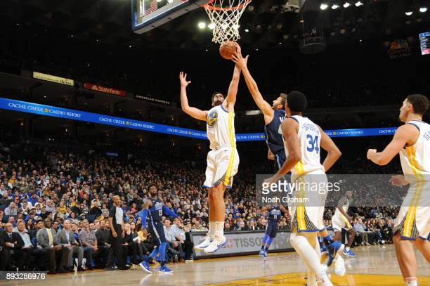 Klay Thompson of the Golden State Warriors grabs the rebound against the Dallas Mavericks on December 14 2017 at ORACLE Arena in Oakland California...