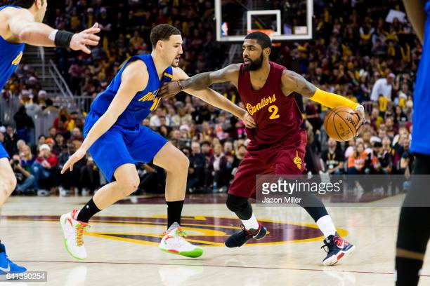Klay Thompson of the Golden State Warriors guards Kyrie Irving of the Cleveland Cavaliers during the second half at Quicken Loans Arena on December...