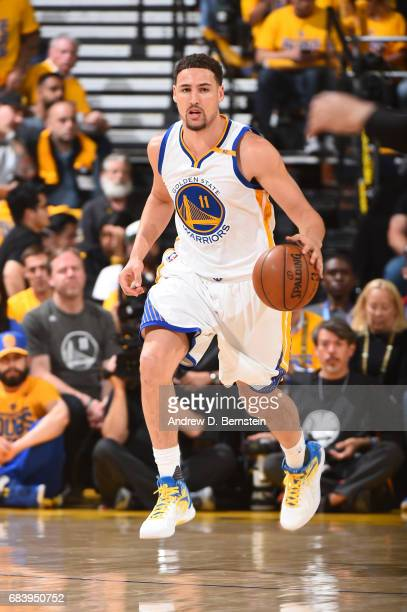 Klay Thompson of the Golden State Warriors handles the ball against the San Antonio Spurs during Game Two of the Western Conference Finals of the...