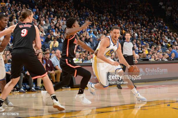 Klay Thompson of the Golden State Warriors handles the ball against the Miami Heat on November 6 2017 at ORACLE Arena in Oakland California NOTE TO...