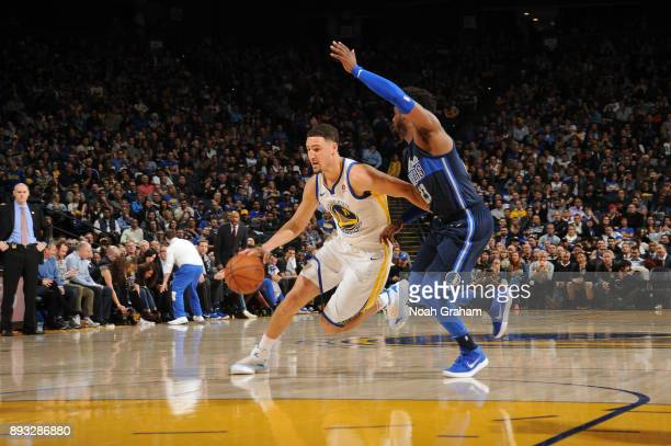 Klay Thompson of the Golden State Warriors handles the ball against the Dallas Mavericks on December 14 2017 at ORACLE Arena in Oakland California...
