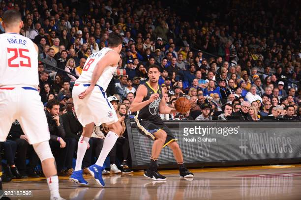Klay Thompson of the Golden State Warriors handles the ball against the LA Clippers on February 22 2018 at ORACLE Arena in Oakland California NOTE TO...