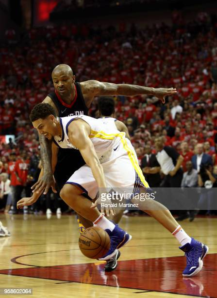Klay Thompson of the Golden State Warriors handles the ball against PJ Tucker of the Houston Rockets in the first half in Game One of the Western...