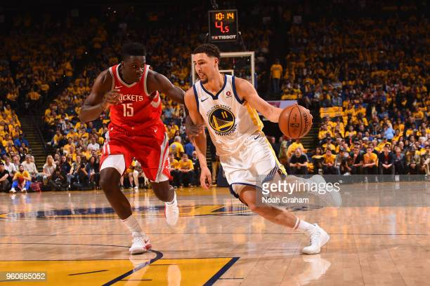 Klay Thompson of the Golden State Warriors handles the ball against the Houston Rockets in Game Three of the Western Conference Finals of the 2018...