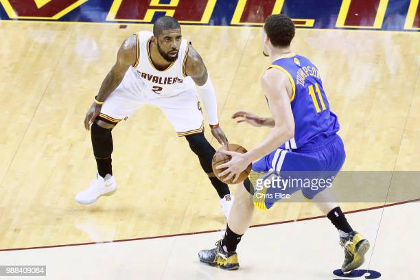 Klay Thompson of the Golden State Warriors handles the ball against Kyrie Irving during Game Three of the 2016 NBA Finals at the Quicken Loans Arena...