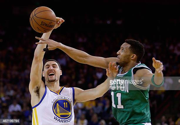Klay Thompson of the Golden State Warriors has a shot blocked by Evan Turner of the Boston Celtics at ORACLE Arena on January 25 2015 in Oakland...