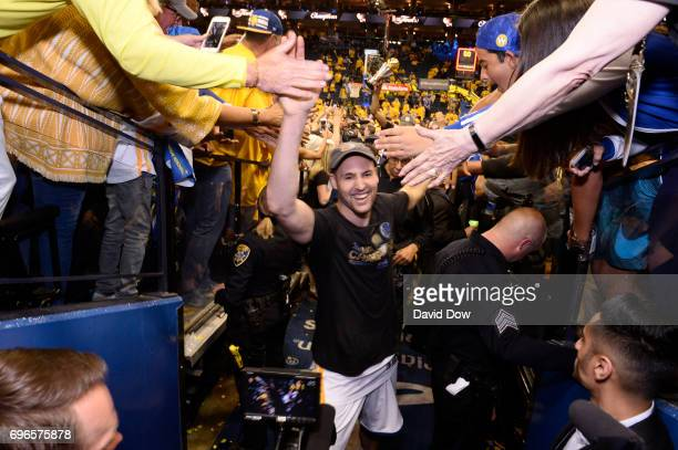 Klay Thompson of the Golden State Warriors high fives fans as he walks off the court after winning Game Five of the 2017 NBA Finals against the...