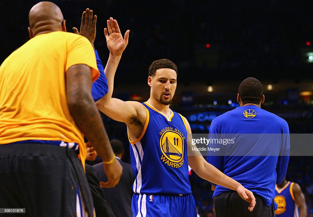 Klay Thompson #11 of the Golden State Warriors high fives teammates during the second half against the Oklahoma City Thunder in game six of the Western Conference Finals during the 2016 NBA Playoffs at Chesapeake Energy Arena on May 28, 2016 in Oklahoma City, Oklahoma.