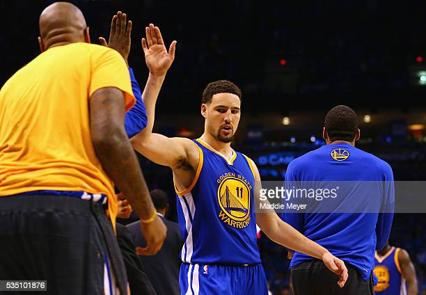 Klay Thompson of the Golden State Warriors high fives teammates during the second half against the Oklahoma City Thunder in game six of the Western...