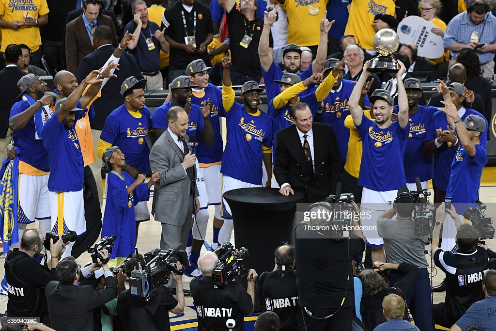 Klay Thompson #11 of the Golden State Warriors holds the Western Conference Championship Trophy after defeating the Oklahoma City Thunder 96-88 in Game Seven of the Western Conference Finals during the 2016 NBA Playoffs at ORACLE Arena on May 30, 2016 in Oakland, California.