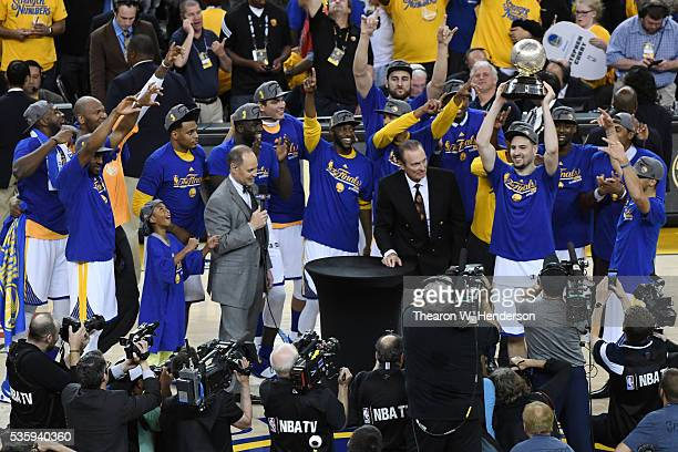 Klay Thompson of the Golden State Warriors holds the Western Conference Championship Trophy after defeating the Oklahoma City Thunder 9688 in Game...