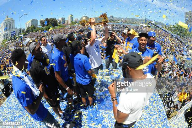 Klay Thompson of the Golden State Warriors holds up the Larry O'Brien Trophy during the Victory Parade and Rally on June 15 2017 in Oakland...