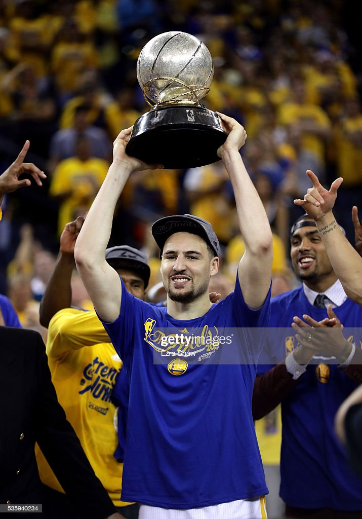 Klay Thompson #11 of the Golden State Warriors holds up the Western Conference Trophy after they beat the Oklahoma City Thunder in Game Seven of the Western Conference Finals during the 2016 NBA Playoffs at ORACLE Arena on May 30, 2016 in Oakland, California.