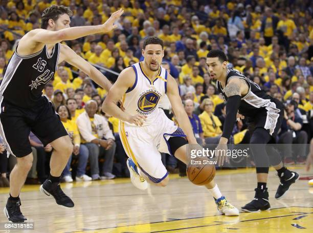 Klay Thompson of the Golden State Warriors in action against the San Antonio Spurs at ORACLE Arena on May 16 2017 in Oakland California NOTE TO USER...