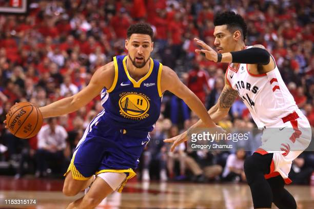 Klay Thompson of the Golden State Warriors is defended by Danny Green of the Toronto Raptors in the first half during Game Two of the 2019 NBA Finals...