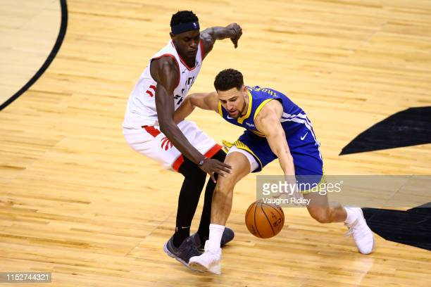 Klay Thompson of the Golden State Warriors is defended by Pascal Siakam of the Toronto Raptors in the second half during Game One of the 2019 NBA...