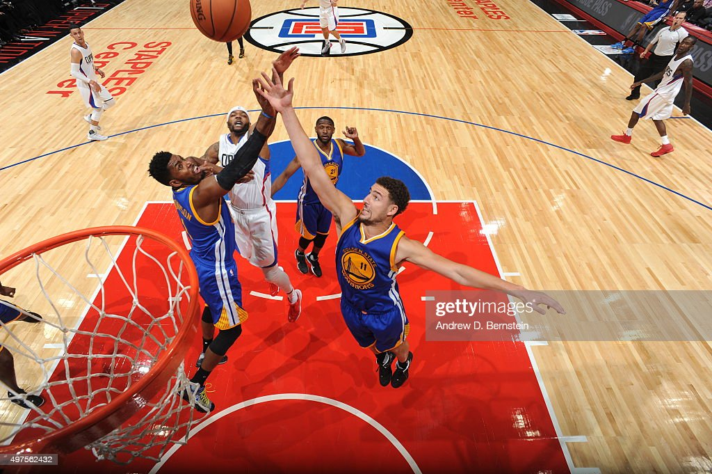 Klay Thompson #11 of the Golden State Warriors, Jason Thompson #1 of the Golden State Warriors and Josh Smith #5 of the Los Angeles Clippers go after a rebound on October 20, 2015 at STAPLES Center in Los Angeles, California.