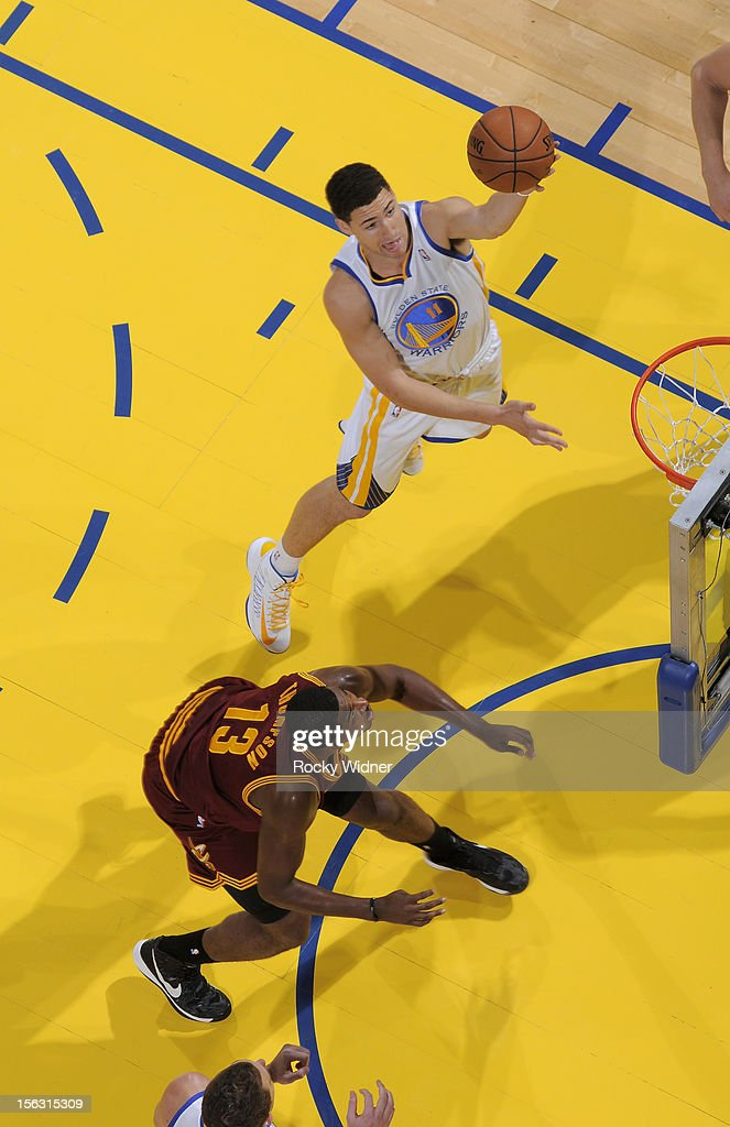 Klay Thompson #11 of the Golden State Warriors lays in the ball against Tristan Thompson #13 of the Cleveland Cavaliers on November 7, 2012 at Oracle Arena in Oakland, California.
