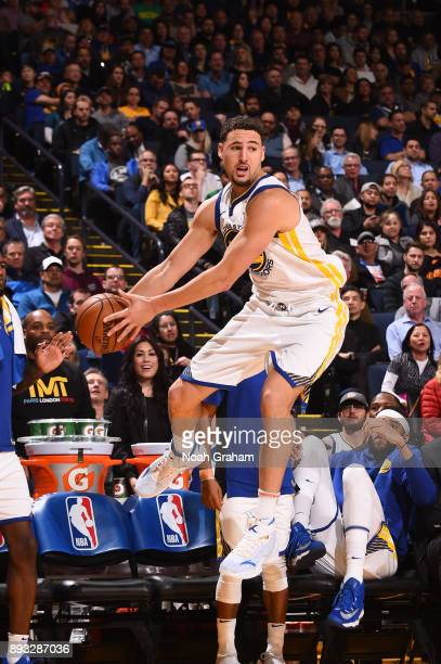 Klay Thompson of the Golden State Warriors looks to pass against the Dallas Mavericks on December 14 2017 at ORACLE Arena in Oakland California NOTE...