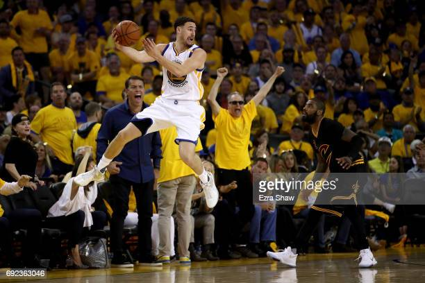Klay Thompson of the Golden State Warriors looks to pass the ball against the Cleveland Cavaliers in Game 2 of the 2017 NBA Finals at ORACLE Arena on...