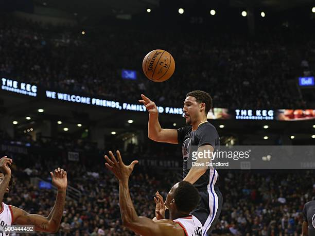 Klay Thompson of the Golden State Warriors makes a pass against the Toronto Raptors on December 5 2015 at Air Canada Centre in Toronto Ontario Canada...