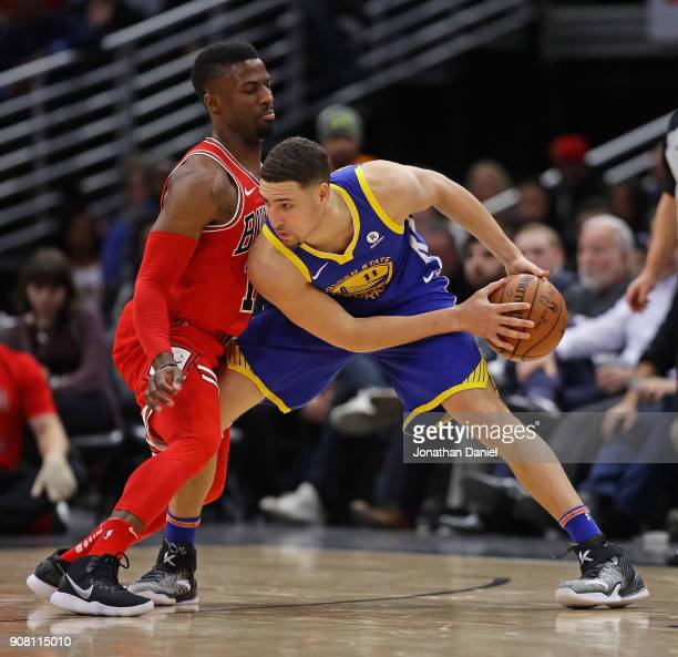 Klay Thompson of the Golden State Warriors moves against David Nwaba of the Chicago Bulls at the United Center on January 17 2018 in Chicago Illinois...