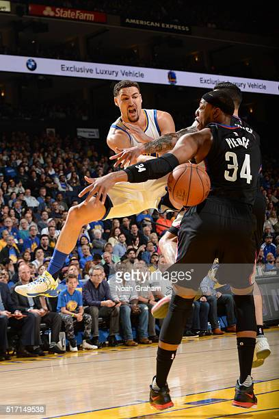 Klay Thompson of the Golden State Warriors moves the ball against Paul Pierce of the Los Angeles Clippers during the game on March 23 2016 at Oracle...