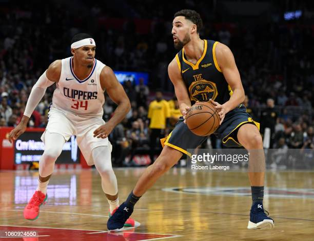 Klay Thompson of the Golden State Warriors plays against Tobias Harris of the Los Angeles Clippers on November 12 2018 at STAPLES Center in Los...