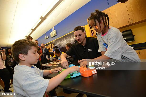 Klay Thompson of the Golden State Warriors plays games with children at the 2016 NBA Finals Cares Legacy project as part of the 2016 NBA Finals on...