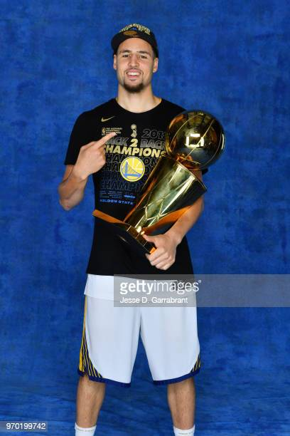 Klay Thompson of the Golden State Warriors poses for a portrait with the Larry O'Brien Championship trophy after defeating the Cleveland Cavaliers in...