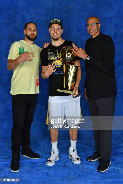 Klay Thompson of the Golden State Warriors poses for a portrait with his brother Mychel Thompson Jr and father Mychel Thompson and the Larry O'Brien...