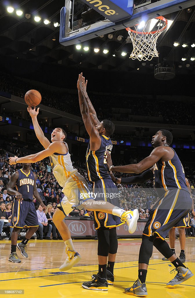 Klay Thompson #11 of the Golden State Warriors puts up a shot against Paul George #24 of the Indiana Pacers on December 1, 2012 at Oracle Arena in Oakland, California.