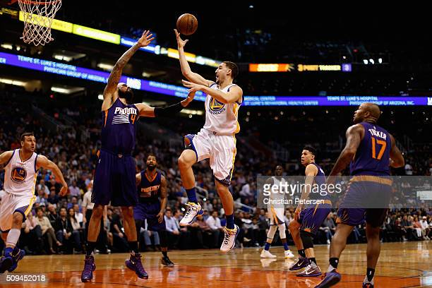 Klay Thompson of the Golden State Warriors puts up a shot over Tyson Chandler of the Phoenix Suns during the first half of the NBA game at Talking...
