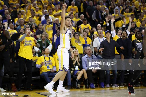 Klay Thompson of the Golden State Warriors reacts after a three pointer against the Cleveland Cavaliers in overtime during Game 1 of the 2018 NBA...