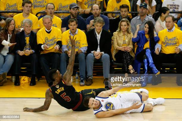 Klay Thompson of the Golden State Warriors reacts after being fouled by JR Smith of the Cleveland Cavaliers in Game 1 of the 2018 NBA Finals at...