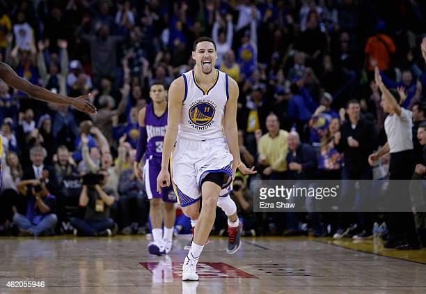 Klay Thompson of the Golden State Warriors reacts after he made a threepoint basket in the third quarter of their game against the Sacramento Kings...