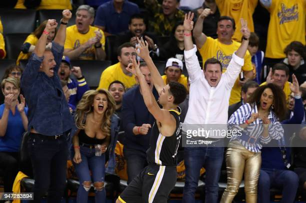 Klay Thompson of the Golden State Warriors reacts after he made a threepoint basket against the San Antonio Spurs during Game 2 of Round 1 of the...