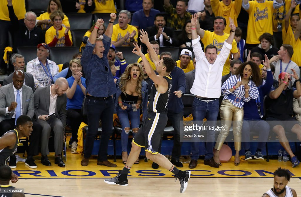 Klay Thompson #11 of the Golden State Warriors reacts after he made a three-point basket against the San Antonio Spurs during Game 2 of Round 1 of the 2018 NBA Playoffs at ORACLE Arena on April 16, 2018 in Oakland, California.