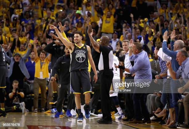 Klay Thompson of the Golden State Warriors reacts after he made a three-point basket at the end of the first half against the New Orleans Pelicans...
