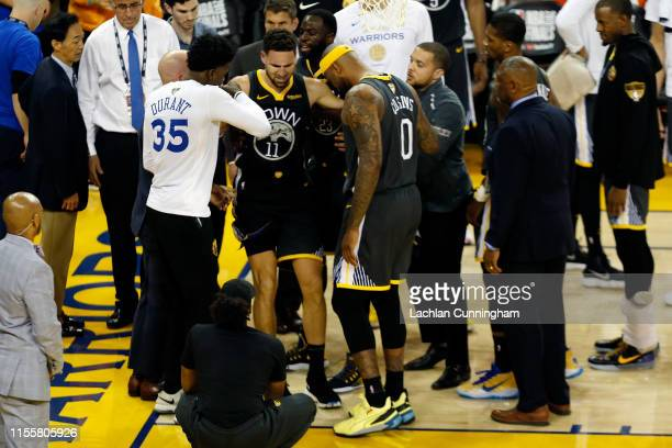Klay Thompson of the Golden State Warriors reacts after hurting his leg against the Toronto Raptors in the second half during Game Six of the 2019...