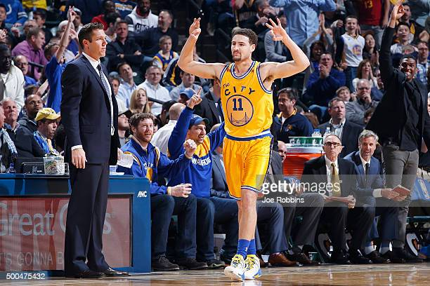 Klay Thompson of the Golden State Warriors reacts after making a threepoint basket against the Indiana Pacers in the first half of the game at...