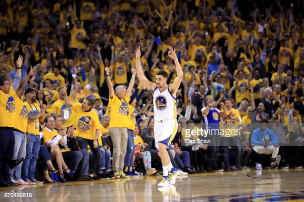 Klay Thompson of the Golden State Warriors reacts after making a three-point basket during their game against the Portland Trail Blazers in Game Two...